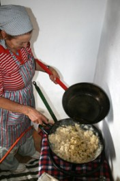 Adding the oil to the migas