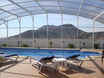 Domed screened pool enclosure